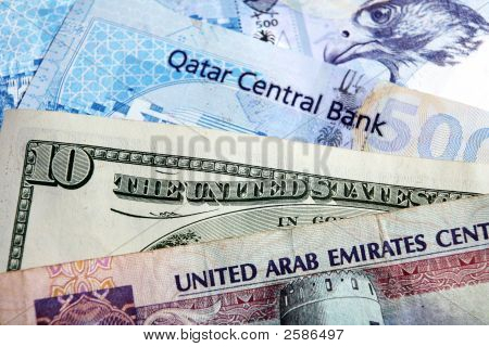 Banknotes of the United Arab Emirates Qatar and the US. In early 2008 there is talk of the Arab Gulf oil and gas producers including Qatar and the UAE breaking their long-standing currency link with the US because the loss of value of the American dollar poster