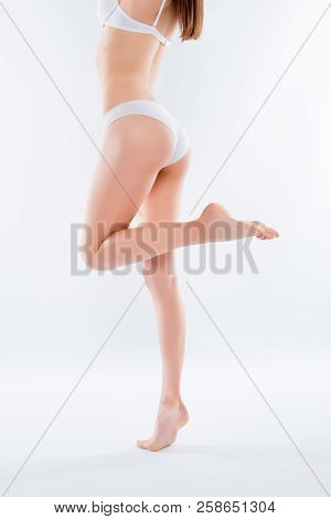 Orange-peel Irritation Concept. Vertical Side Profile View Photo Of Long Beautiful Woman's Legs Stan