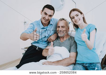 Happy Family In Clinic. Young And Old People In Hospital. Care Young People About Old Man. Health Ol