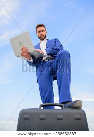 Man Well Groomed Businessman Holds Laptop Blue Sky Background. Confident Entrepreneur. Top Qualities