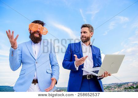 Businessman With Laptop Serious While Business Partner Ridiculous Glasses Looks Funny. How To Stop P