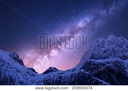 Milky Way Above Snowy Mountains. Space. Fantastic View With Snow Covered Rocks And Starry Sky At Nig