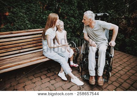 Family Together And Old Man. Caregiver Child With Old Man. Disease Old Man In Wheelchair. Old Man An