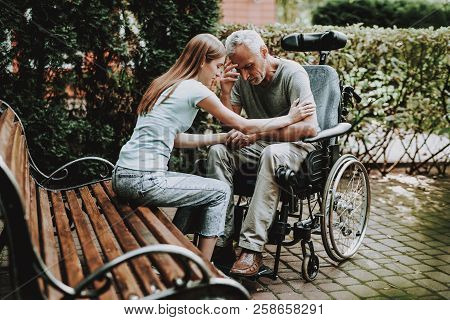 Old Man And Young Girl. Old Man And Woman. Wheelchair And Old Man On Nature. Wheelchair And Elderly