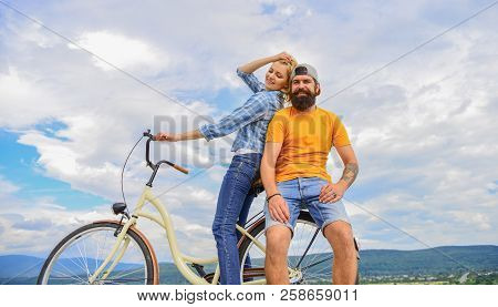 Date Ideas. Man And Woman Rent Bike To Discover City. Couple In Love Date Outdoors Cycling. Bike Ren