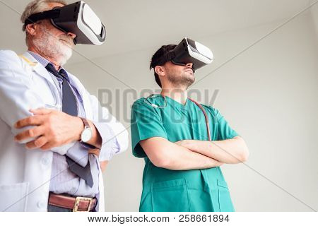 Portrait Of Doctor Team Are Using Virtual Reality Technology To Examination Physical Body Patient.,