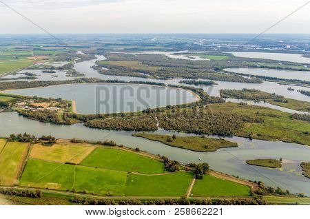 Aerial Photo Of Artificially Constructed Water Basins In The Dutch National Park De Biesbosch. In Th