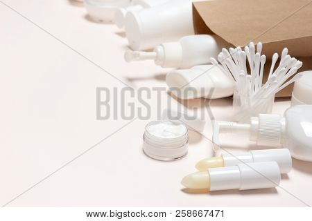 Cosmetic Products With Paper Merchandise Bag. Buying Cosmetics, Beauty Shopping. Side View, Empty Sp