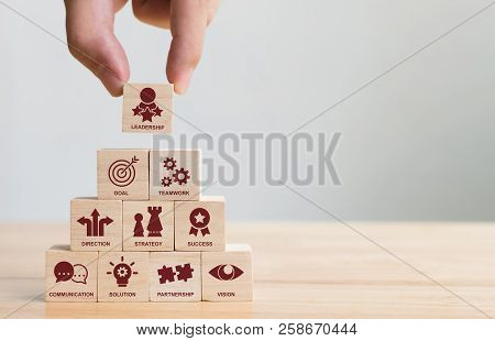 Hand Arranging Wood Block Stacking With Icon Leader Business. Key Success Factors For Leadership Ele