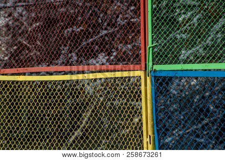 Grunge Texture With Multi Colored Metal Mesh Fence