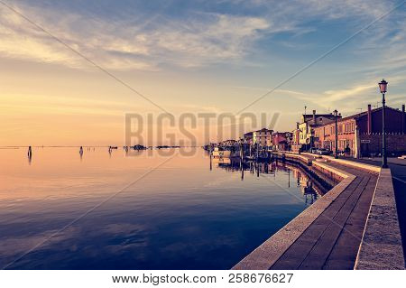 Romantic Sunset On The Venice Lagoon. Island Of Pellestrina And Town.