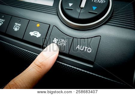 Finger Pressing On Power Switch Of A Car Air Conditioning System
