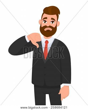 Young Business Man Showing Thumbs Down Sign, Dislike, Looks With Negative Expression And Disapproval