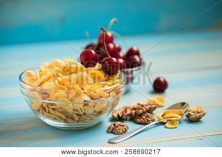 Tasty Cornflakes With Walnut In Glass Bowl