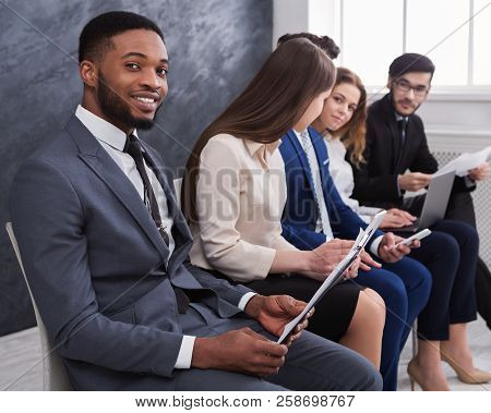 Multiracial Business People Waiting In Queue And Preparing For Job Interview