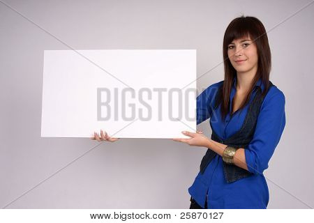 Woman holding blank board.