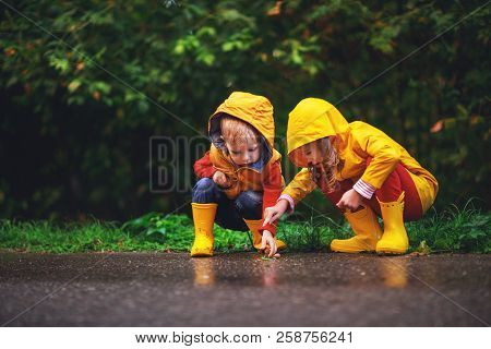Happy Children Boy And Girl On Autumn Walk