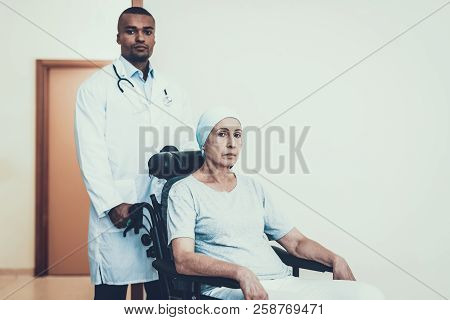 Doctor In Clinic. Woman Rides To The Ward. Patient Undergoes Rehabilitation. After Treatment For Can