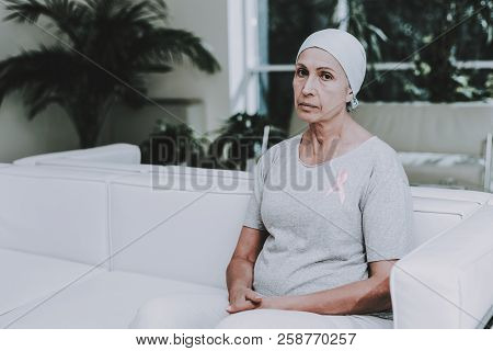 Patient Undergoes Rehabilitation. After Treatment For Cancer. Cancer Patient On Sofa. Recovering Wom