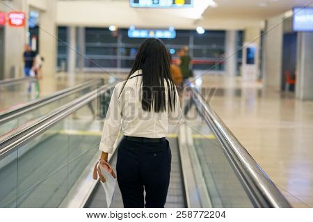 Women At Horizontal Escalator Covered. Moving Walkway, Moving Sidewalk, Moving Pavement, Autopedesca