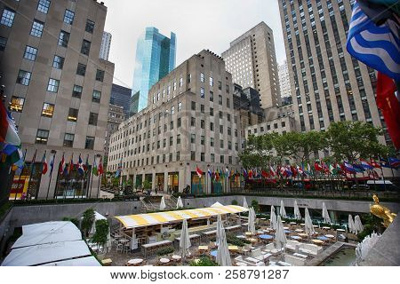 New York, Usa - August 23, 2018: Rockefeller Center, Flagpoles With Flags Of United Nations Member C