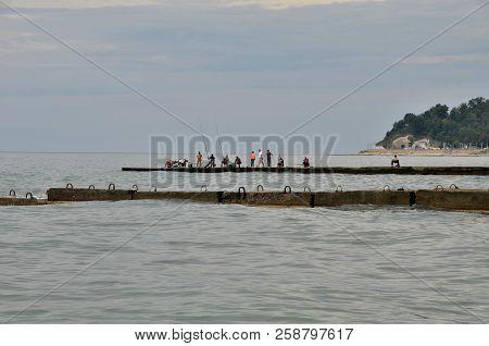 Sochi, Russia September, 2013: View Of Fishermen On  Beach In The Sochi, Russia