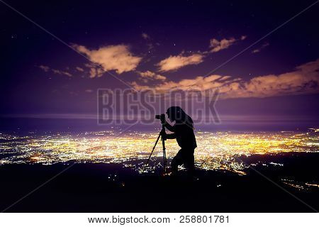 Photographer At Night Sky