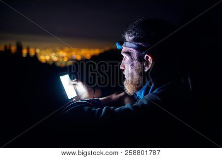 Man With Phone At Night Sky