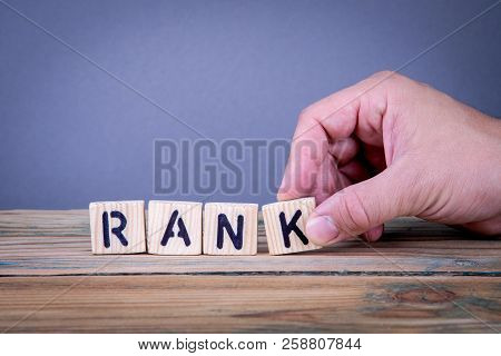 Rank. Wooden Letters On The Office Desk, Informative And Communication Background