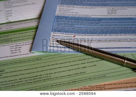 Chrome Pen Resting On Loan Application Form