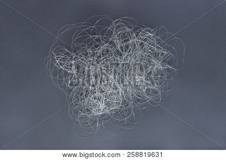 Silver Thread Pile Like Cloud. Pile Of Silver Thread On Grey Background.