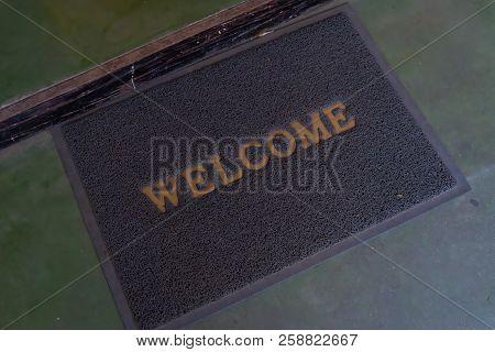 Welcome Doormat In Front.