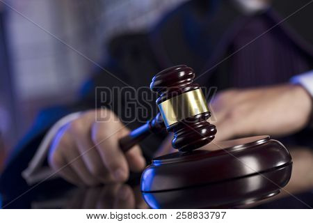 Judge In The Courtroom. Male Judge Striking The Gavel.