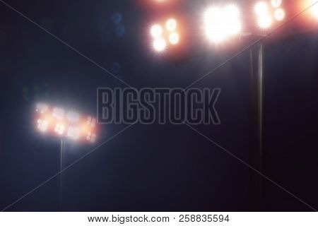 Stadium Lights In Sport Game In Dark Night Sky Background