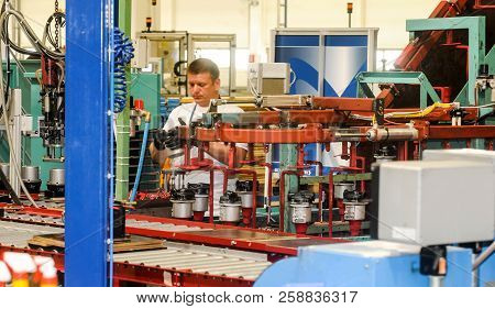 Belgrade, Serbia - Circa May 2013: Workers On Assembly Line In Hidraulic Pumps Factory, Circa May 20