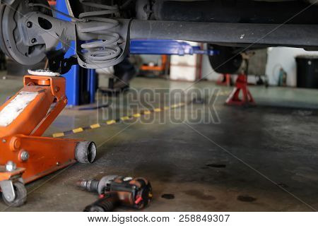 Car Lift Up For Shock Absorber & Spring Replacement In Auto Repair Garage