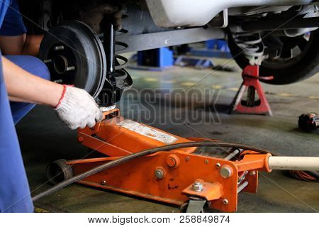 Mechanic Replace Shock Absorber & Spring In Auto Service Repair Garage