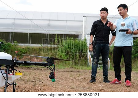 Chiang Mai, Thailand - September 7, 2018: Man Controlling Agriculture Drone For Spraying Liquid Fert