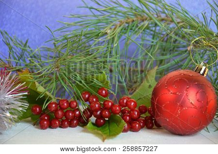 Christmas Decorations. Holly, Spruce, Red Berries, Christmas Bauble, Conifer Cone. Red Ball