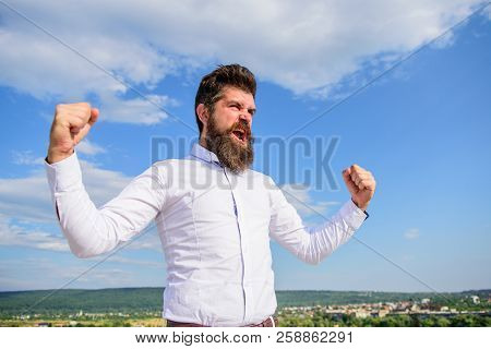 Man Bearded Hipster Feels Powerful And Full Of Energy When Reached Top Achievement. Man Emotional En
