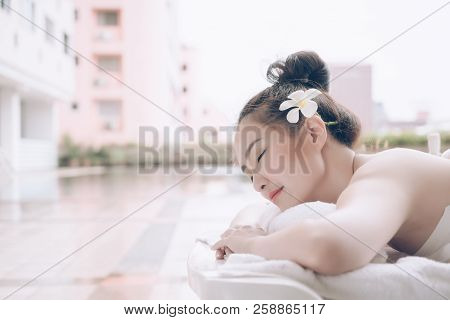 Beautiful Asian Woman Relaxing With Hand Massage Treatment At Beauty Spa. Young Happy Girl In Spa Sa