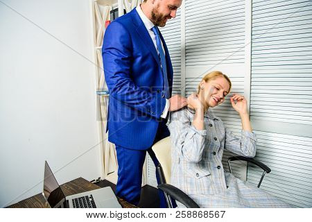 Tired Woman Worker Relaxing While Man Massaging Her. Behavior Rule And Subordinate At Work. Boss Una