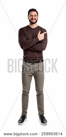 A Bearded Man In Casual Clothes Smiles With His Arms Folded But Still Indicating Sideways With His I