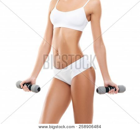 Fit And Beautiful Woman In Swimsuit. Sporty Girl With Dumbbells. Fitness, Diet And Healthy Lifestyle
