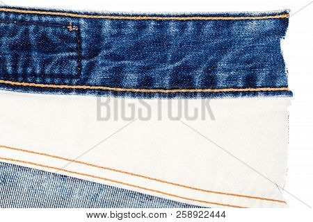 Piece Of Blue Jeans And White Fabric Isolated On White Background. Rough Uneven Edges. Denim Jeans T