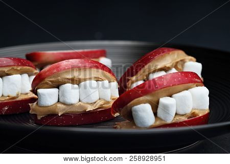Fun Food For Kids. Halloween Apple Mouths Filled With Peanut Butter With Mini Marshmallows For Teeth