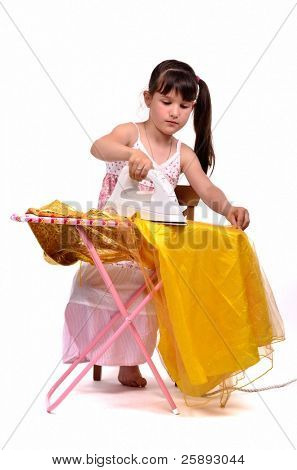 Dangerous housework - little, brunette hair girl ironing her dress