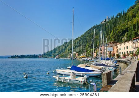 Harbor and the yachts in small town of Toscolano on Lake Garda, Italy