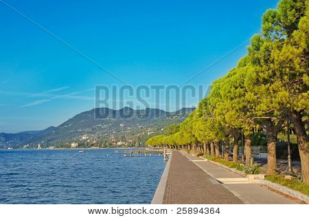 Promenade in Toscolano town on a Garda lake, Italy