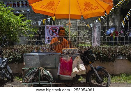 Dumaguete, The Philippines - 10 September 2018: Street Food Seller With Mobile Stall On Motorcycle.